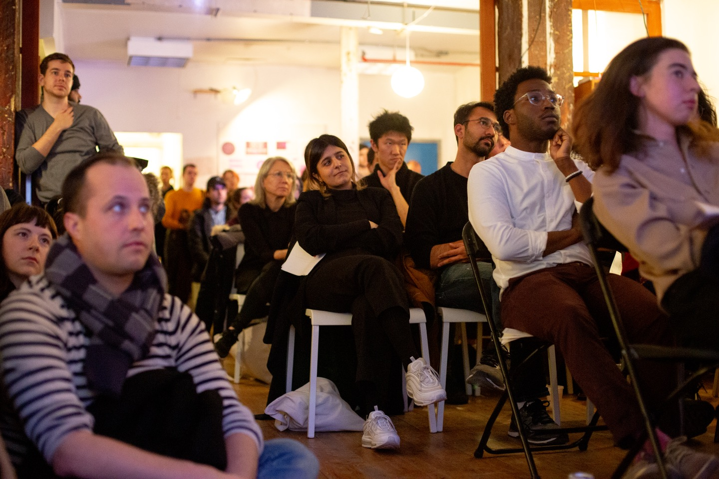 """Room full of people at SFPC seated and listening to Code Societies Winter 2019 student presentations."""