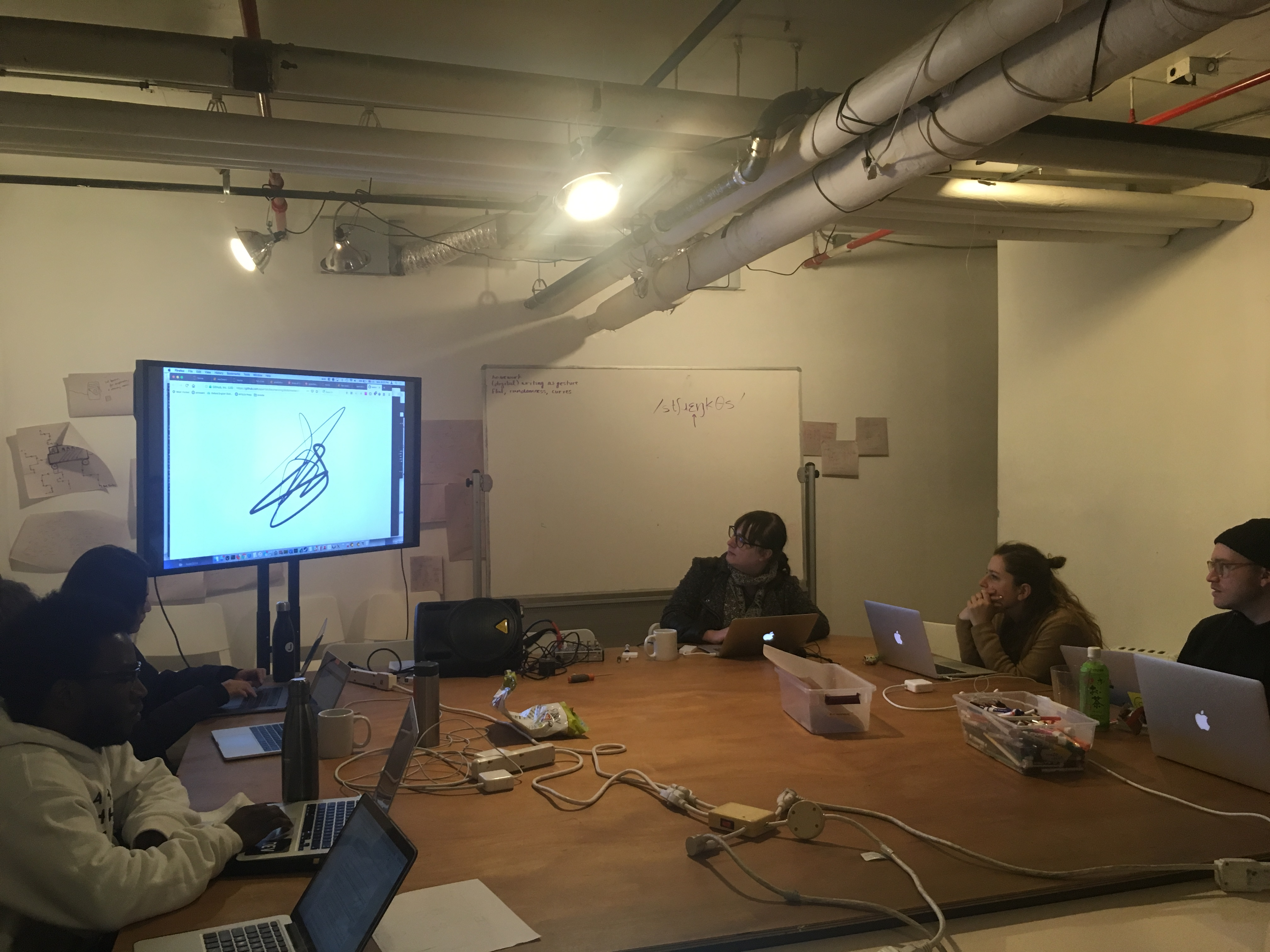 """""""Allison Parrish, discussing letterforms on whiteboard"""""""