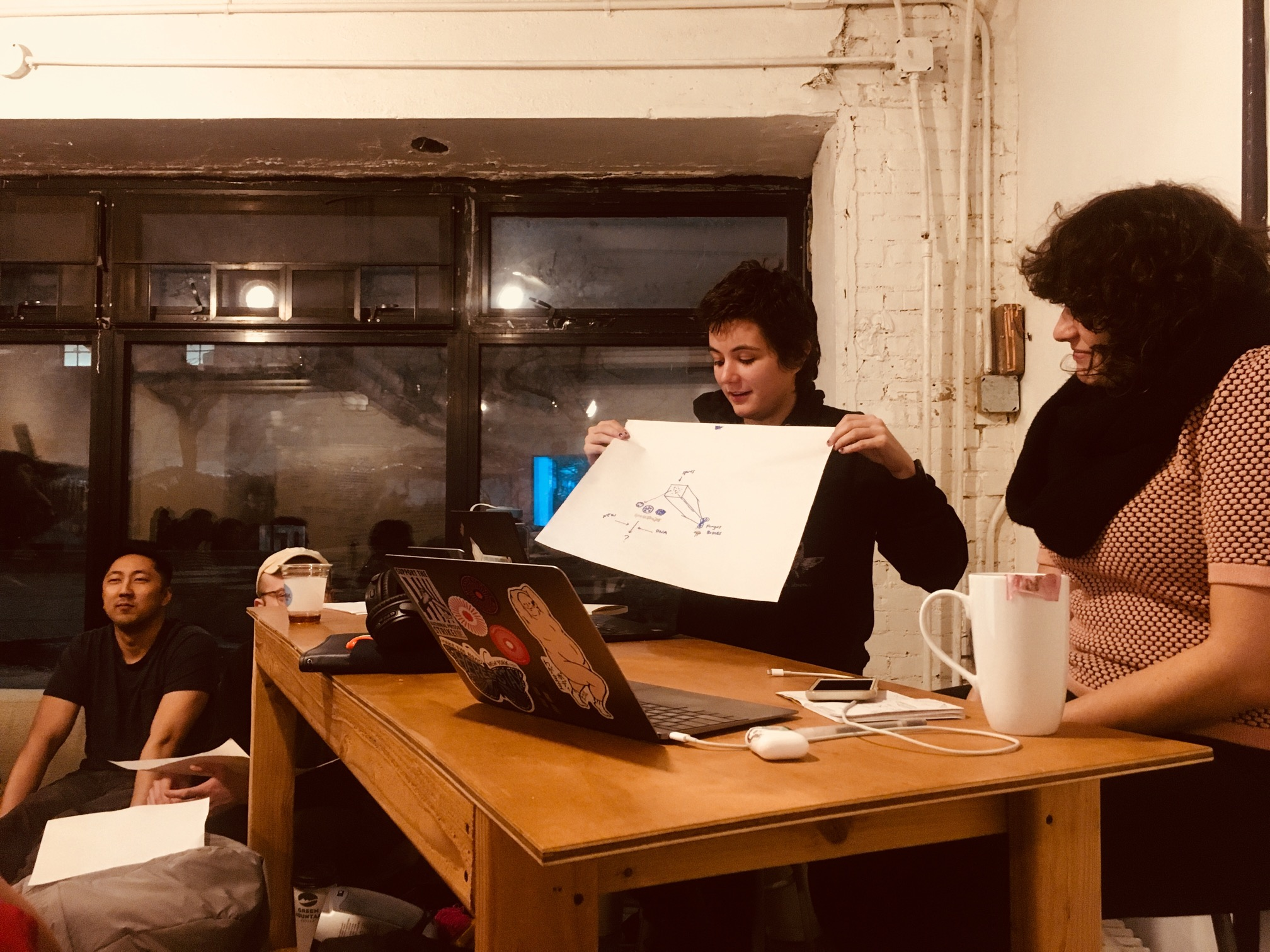 """""""AC Gilette presenting a collaborative drawing done with Nadja Oertelt."""""""