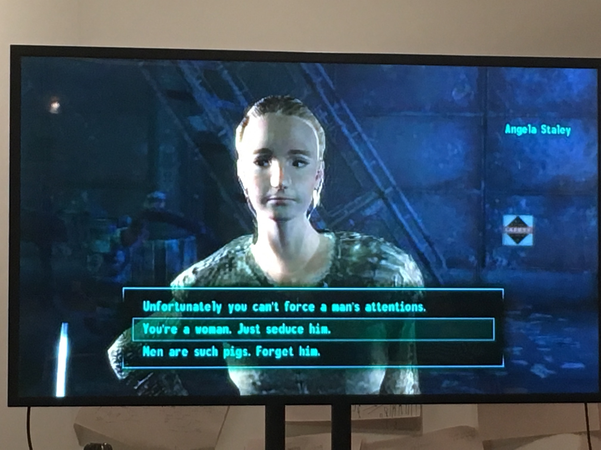 """""""Screenshot from Nora's presentation showing a female presenting character from Fallout 1 with the options: Unfortunately you can't force a man's attention; You're a woman. Just seduce him; Men are such pigs. Forget him."""""""